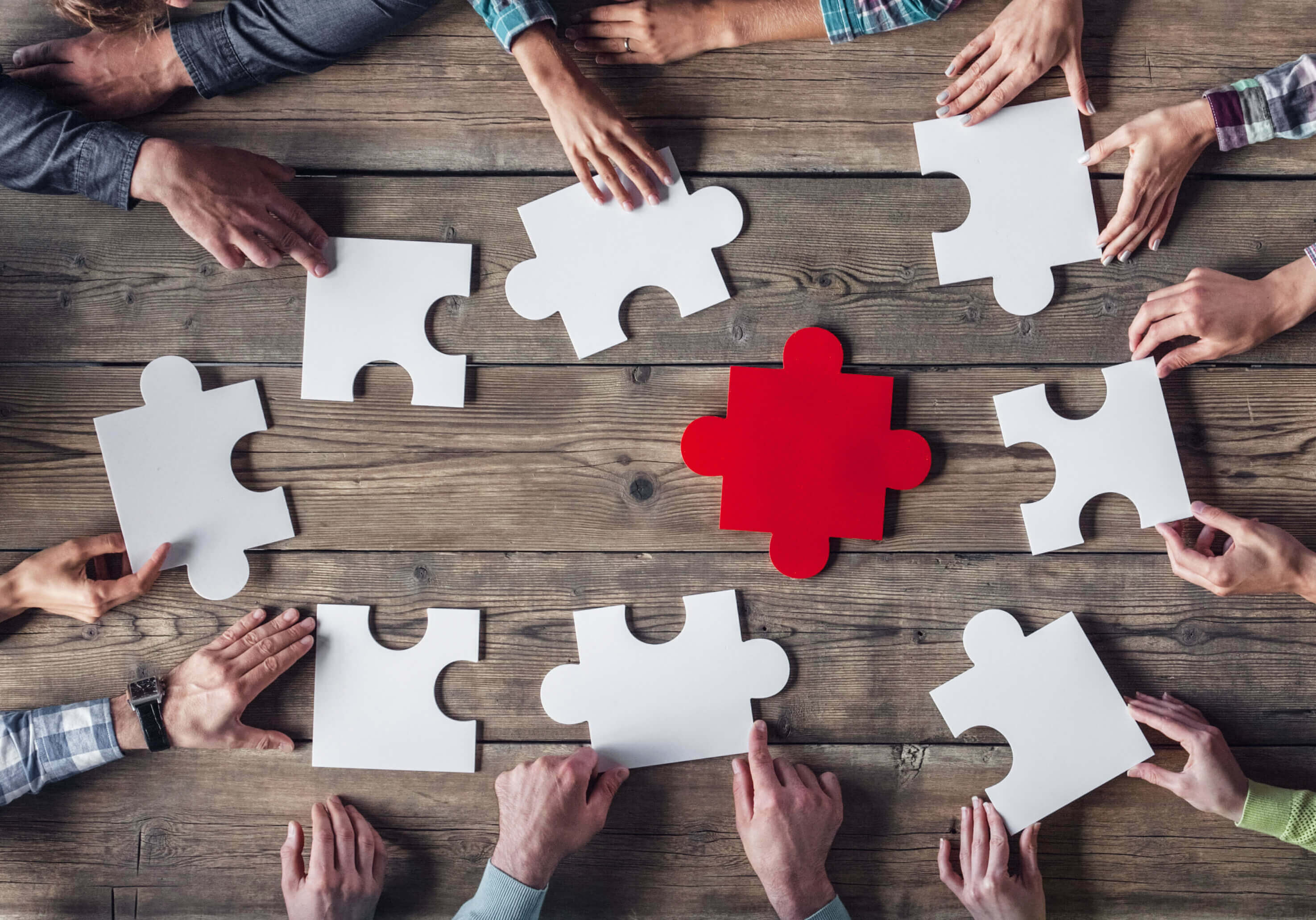 Hipster business successful teamwork concept, business group assembling jigsaw puzzle